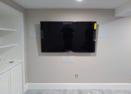 Mounted Television with 5.1 Surround concealed in wall and ceiling.