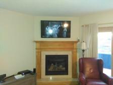TV Hang over fireplace.